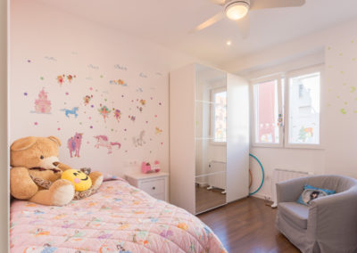 Habitación infantil Reforma para unir dos viviendas en Alicante por Araque Maqueda